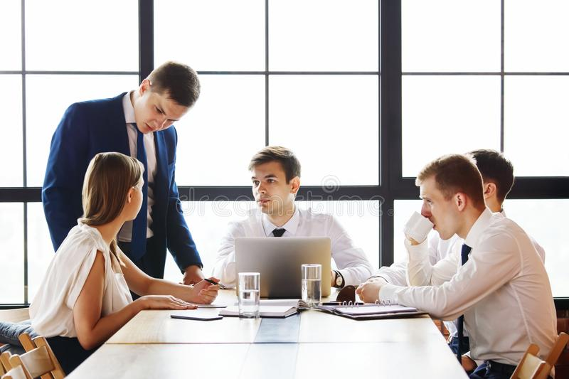 Group of young business people working in office. royalty free stock photos