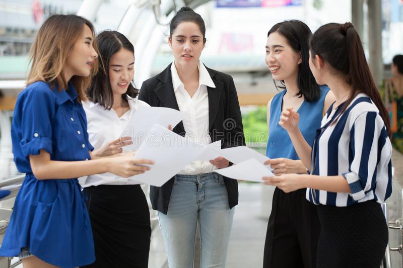 Group of young businesswomen meeting in a conference wiht paper work and document outside office in urban city. Group of young business women meeting in a royalty free stock photos
