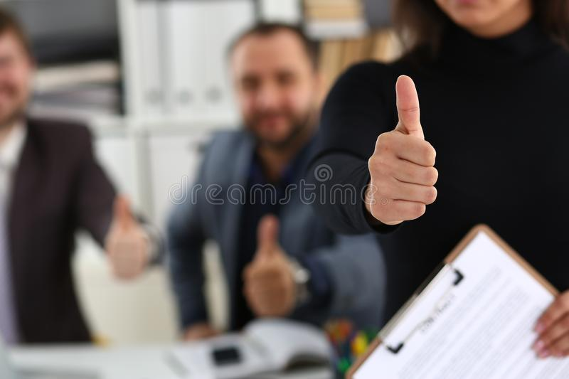 Group of young businessmen are happy make good deal show big finger stock images