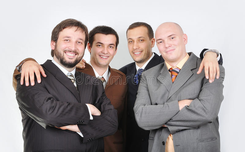 Group of young businessmen together. On light background royalty free stock photography