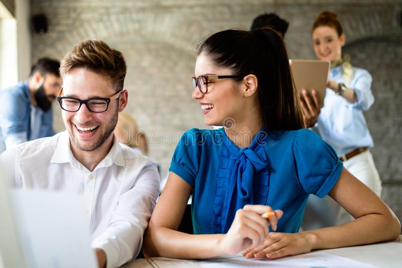 Group of young businesspeople or designers work with new startup project in office stock photo