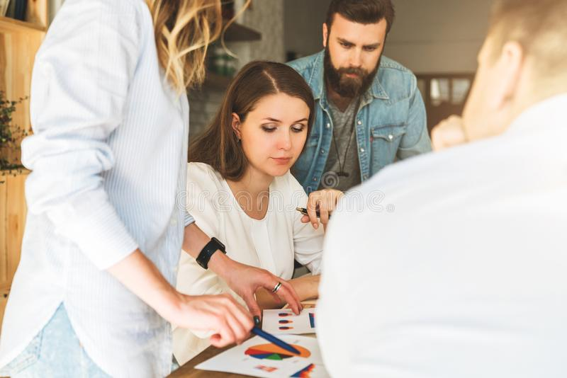 Group of young businesspeople work together. Brainstorming, teamwork, startup, business planning. Hipsters learning royalty free stock image