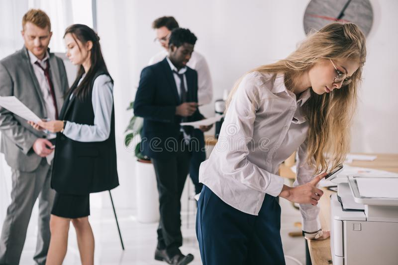 group of young businesspeople working together stock image