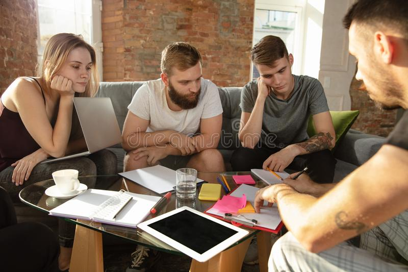 Group of young caucasian office workers have creative meeting to discuss new ideas stock photos
