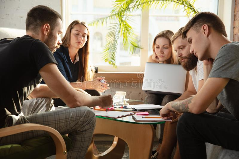 Group of young caucasian office workers have creative meeting to discuss new ideas royalty free stock images