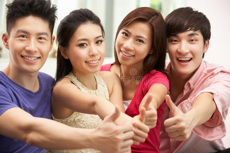 Download Group Of Young Chinese Friends Relaxing At Home Stock Image - Image: 26245357