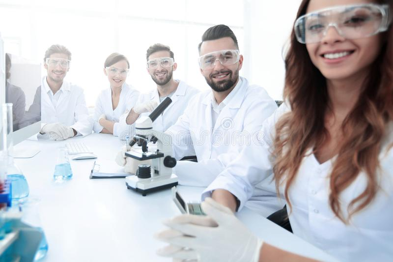 Group of young clinicians experimentation in research laboratory royalty free stock photo