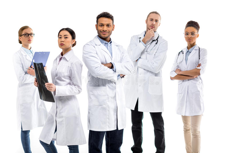 Group Of Young Confident Professional Doctors In White Coats ...