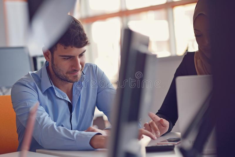 Group Young Coworkers Making Great Business Decisions. Creative Team Discussion Corporate Work Concept Modern Office. stock photography