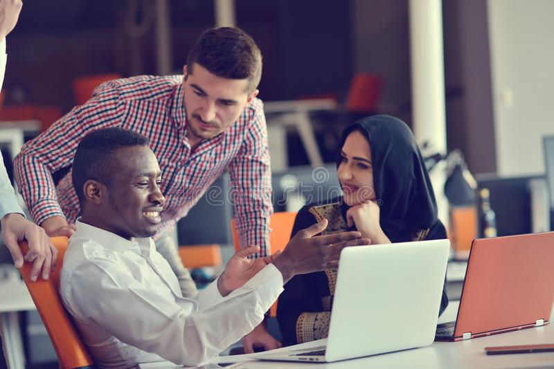 Group Young Coworkers Making Great Business Decisions. Creative Team Discussion Corporate Work Concept Modern Office. New Startup Marketing Idea Presentation stock photo
