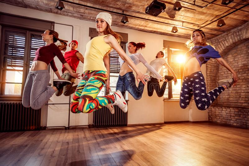 Group of young dancer jumping during music royalty free stock image