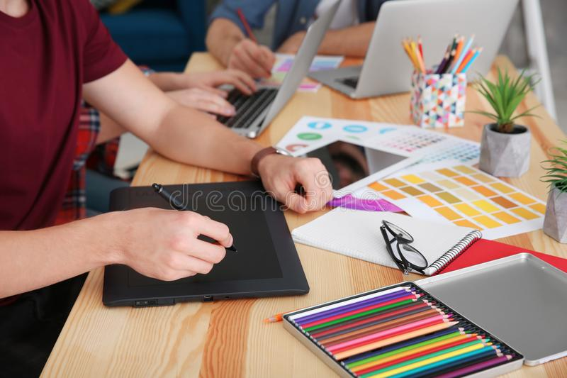 Group of young designers working royalty free stock photography