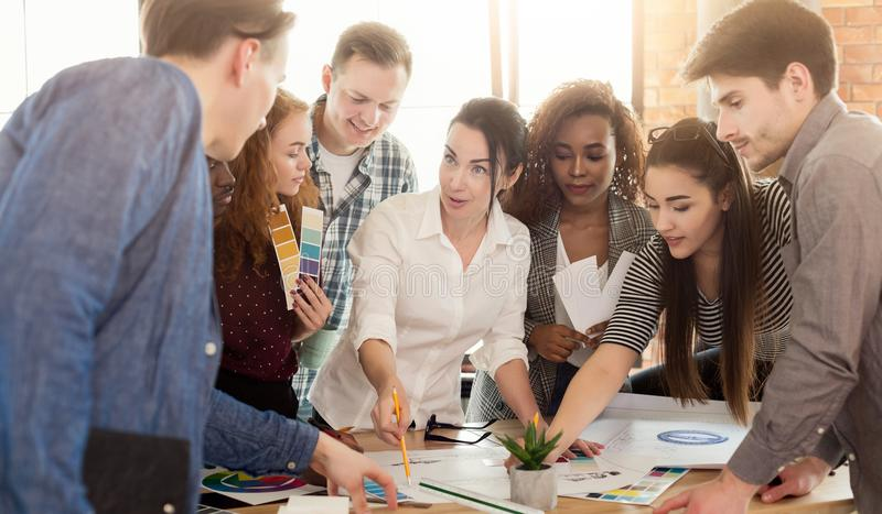 Group of young designers working with project royalty free stock photos