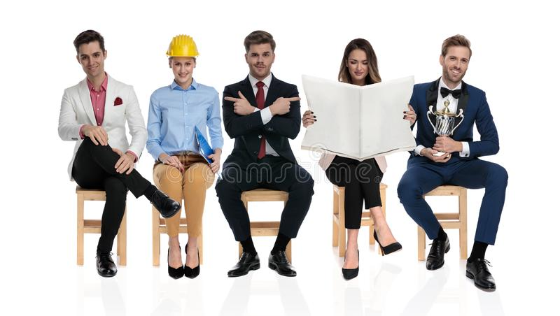 Group of young different people waiting for a job interview royalty free stock photography