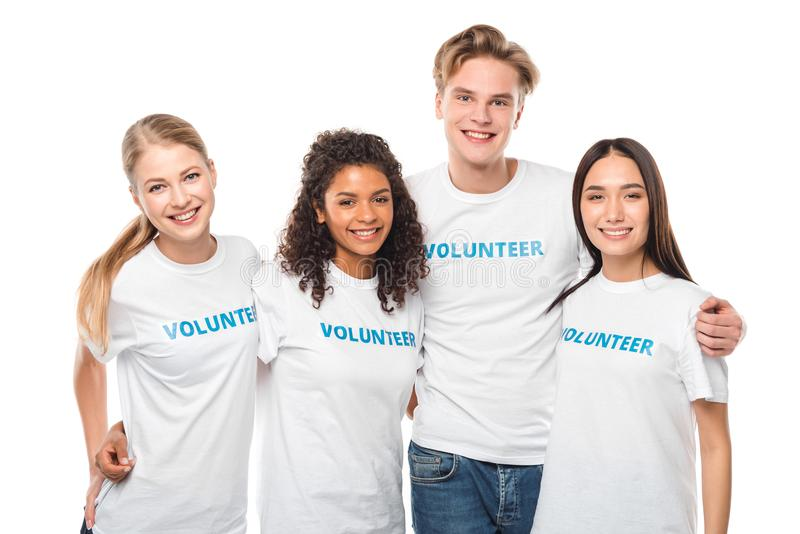 Young embracing volunteers. Group of young embracing volunteers isolated on white royalty free stock image