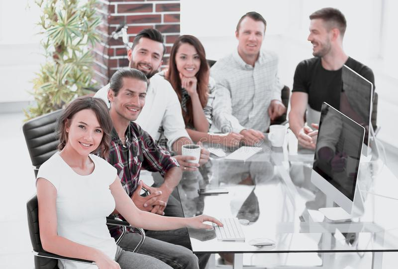 Group of young employees discussing ideas. In the workplace royalty free stock photo
