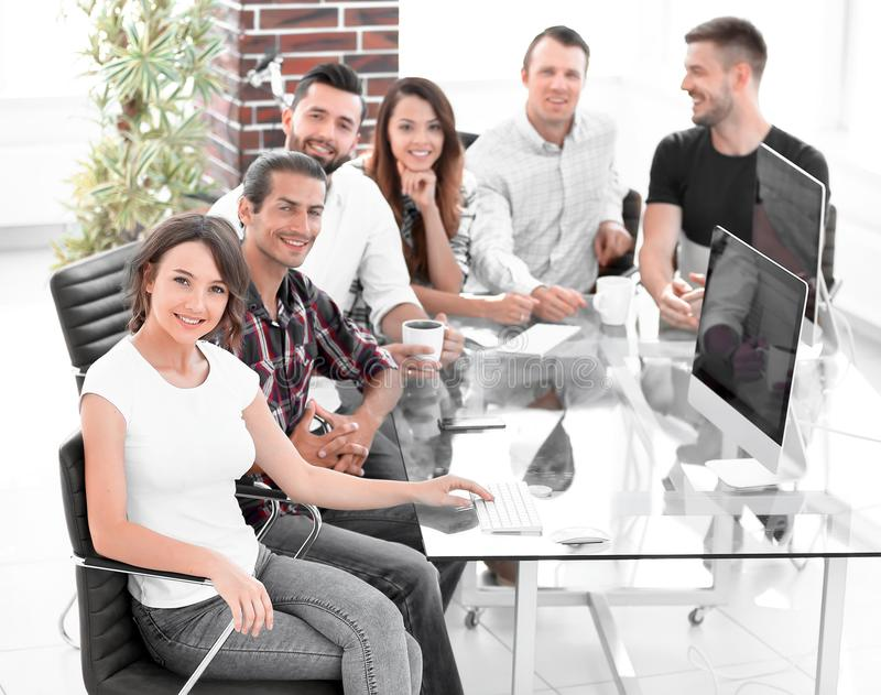Group of young employees discussing ideas stock images