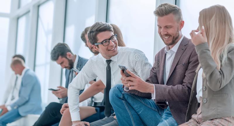 Group of young employees discussing online news. stock images