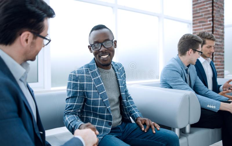Group of young employees are waiting for an interview in the office lobby stock photography