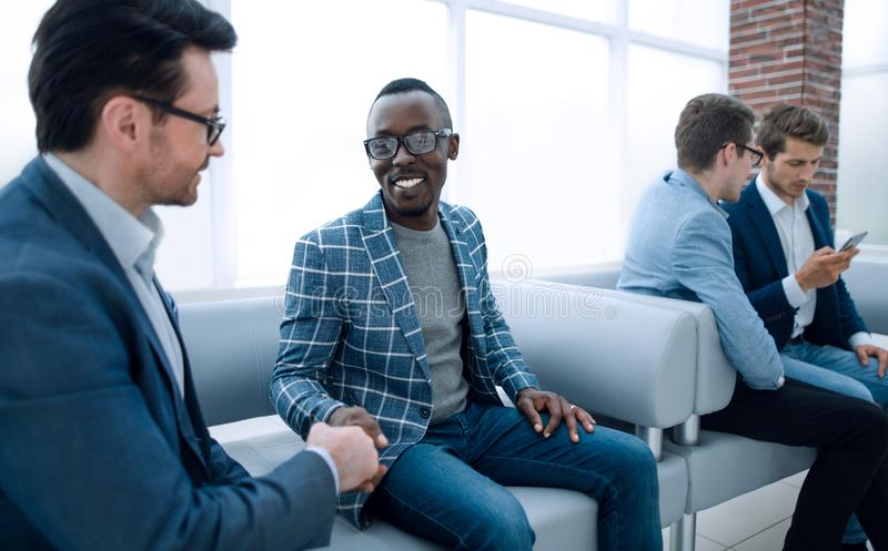 Group of young employees are waiting for an interview in the office lobby royalty free stock image