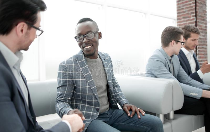 Group of young employees are waiting for an interview in the office lobby stock photo