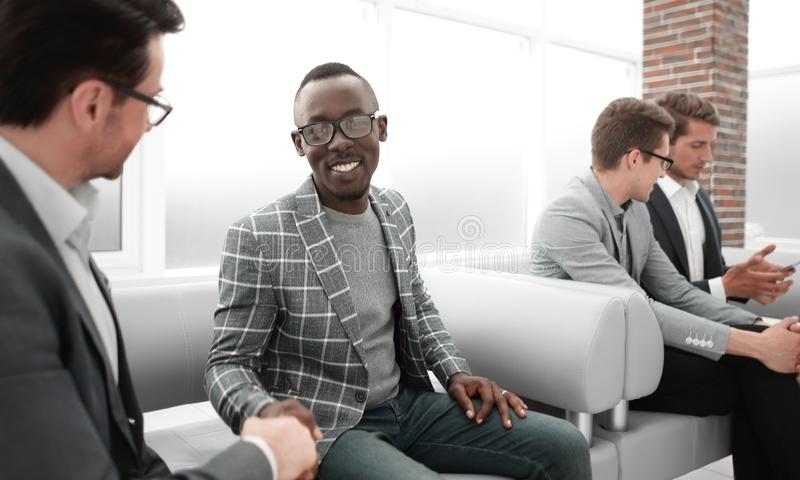 Group of young employees are waiting for an interview in the office lobby stock images