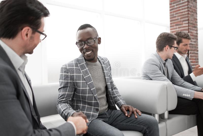 Group of young employees are waiting for an interview in the office lobby royalty free stock images