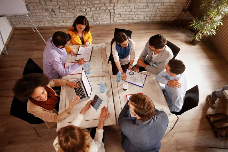 Group of employees working in office, top view stock images