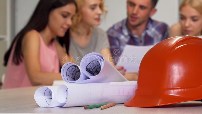 Group of young engineers working at the office royalty free stock images