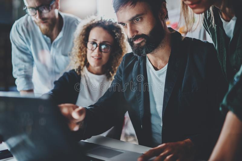 Group of young entrepreneurs are looking for a business solution during work process at night office.Business people royalty free stock images