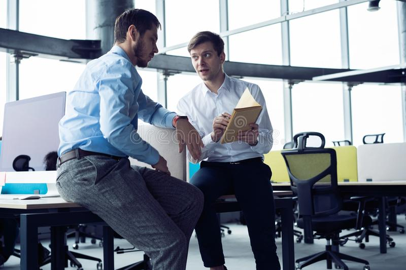 Group of young entrepreneurs are looking for a business solution during work process at office.Business people meeting royalty free stock photo