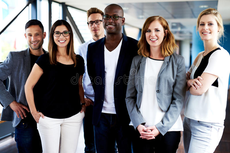 Group of young executives posing for picture stock photos