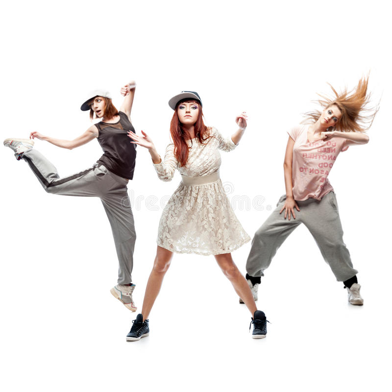 Group of young femanle hip hop dancers on white background. Group of young female hip hop dancers isolated on white background stock images