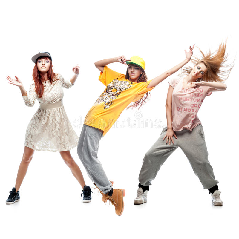 Group of young femanle hip hop dancers on white background. Group of young female hip hop dancers isolated on white background royalty free stock image