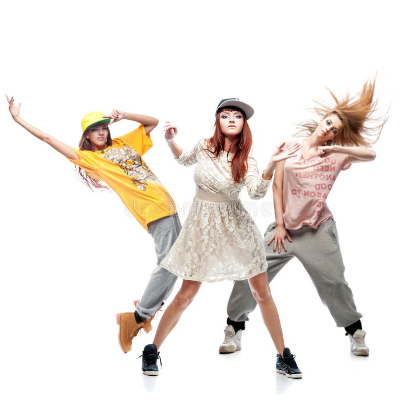 Group of young femanle hip hop dancers on white background. Group of young female hip hop dancers isolated on white background stock image