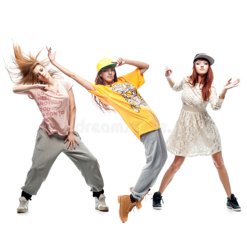 Group of young femanle hip hop dancers on white background. Group of young female hip hop dancers isolated on white background stock photos