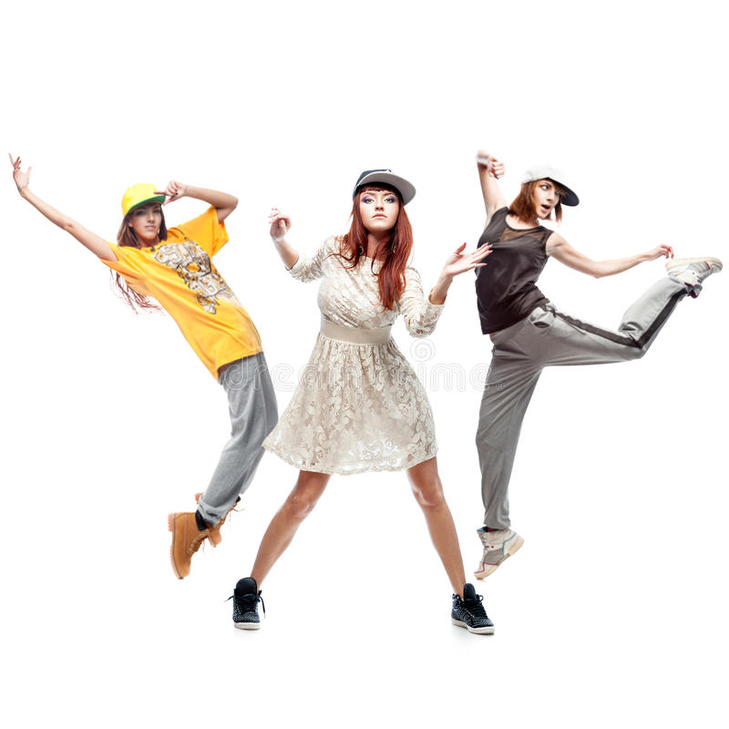 Group of young femanle hip hop dancers on white background. Group of young female hip hop dancers isolated on white background royalty free stock photo