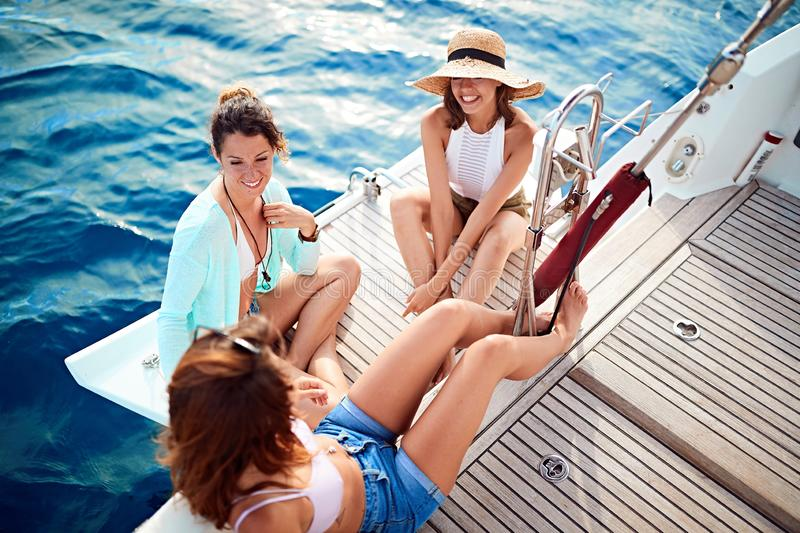 Group of friend's girl on the boat together enjoy at summer holiday royalty free stock photos