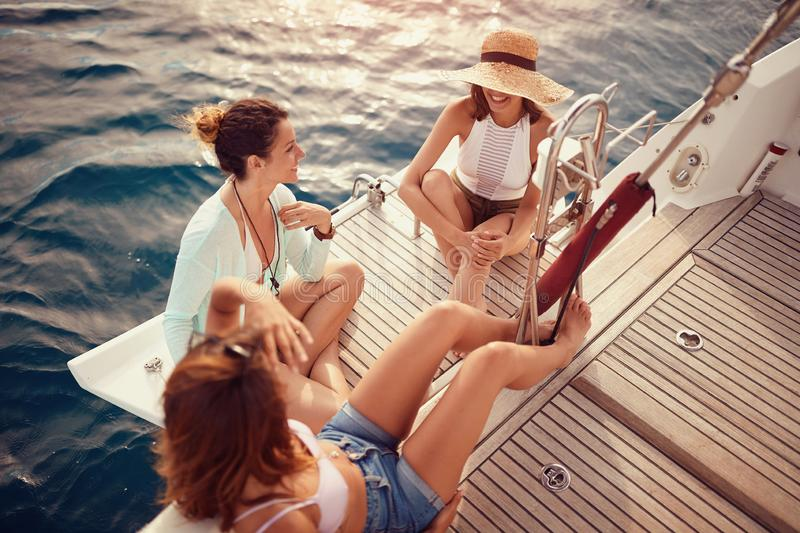 Group of friend's girl on the luxury boat together enjoy royalty free stock photos