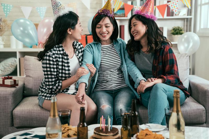 Group of young friends celebrating in home stock photography