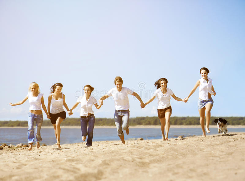 Group young friends enjoying a beach party on vacation. People h royalty free stock photos