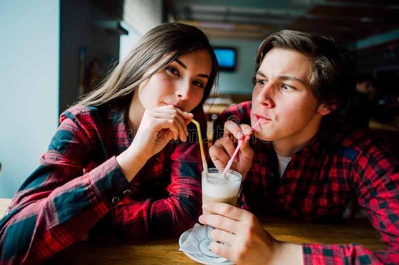 Group of young friends hanging out at a coffee shop. Young men and women meeting in a cafe having fun and drinking coffee. Lifesty stock photos