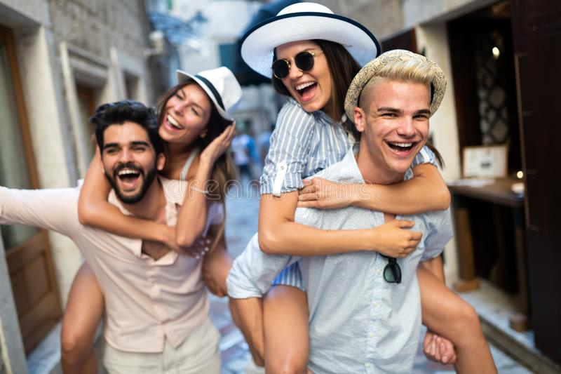 Group of young friends hangout on city street royalty free stock images