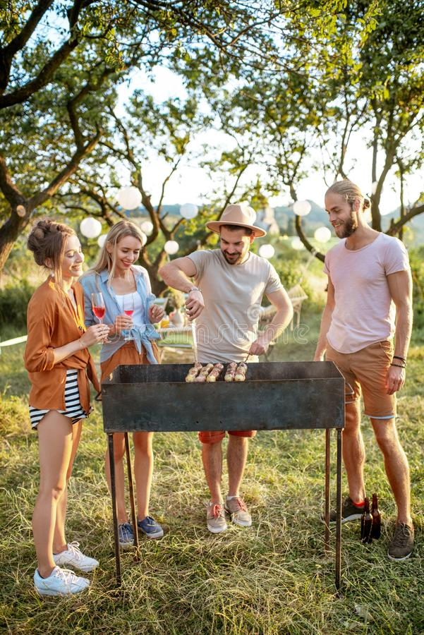 Friends having barbecue in the garden stock image