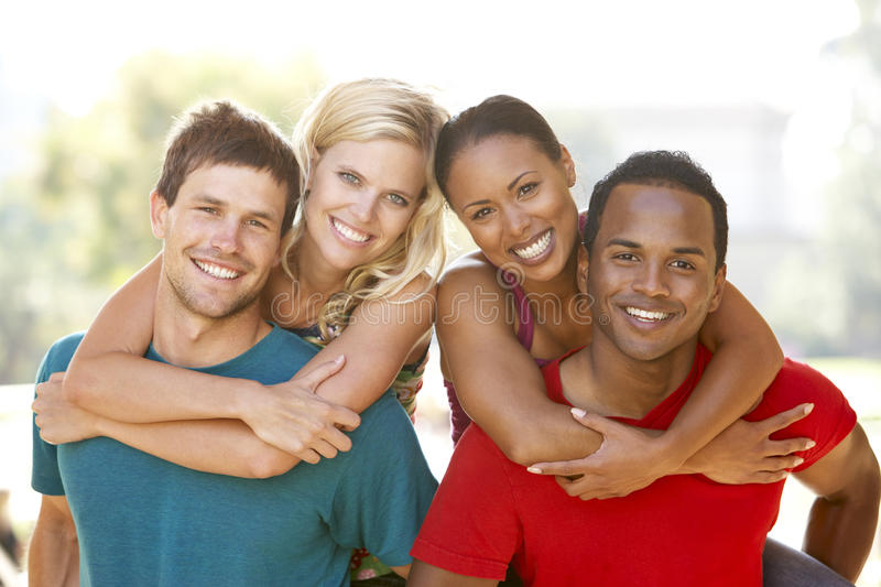 Group Of Young Friends Having Fun Together. Smiling To Camera, Piggyback stock image