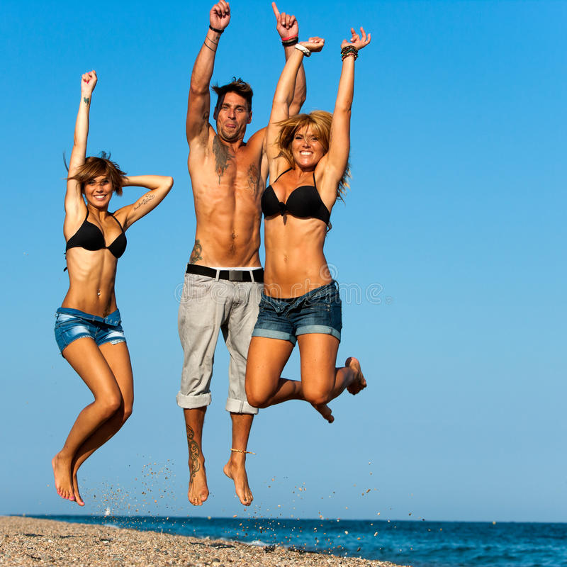 Download Group Of Young Friends Jumping On Beach. Stock Image - Image: 26767275