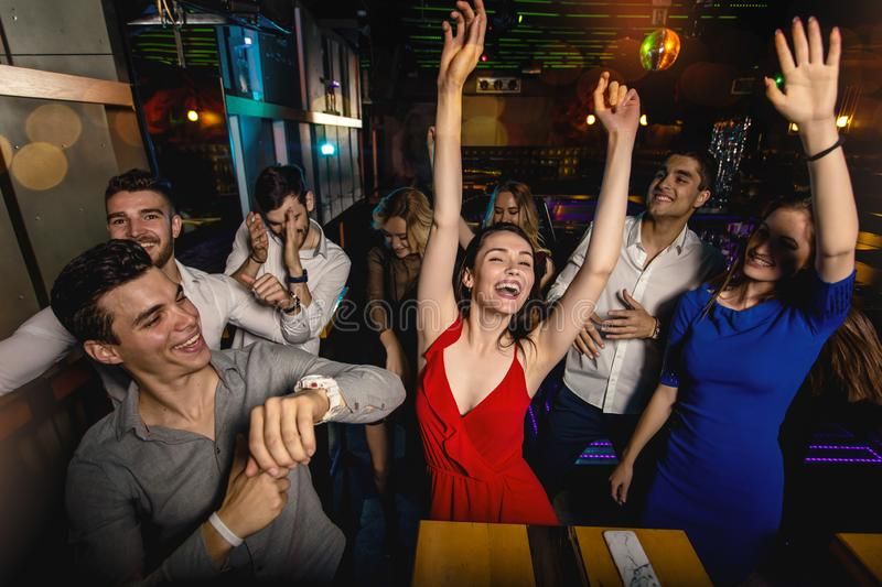 Group of friends partying in a nightclub royalty free stock photos