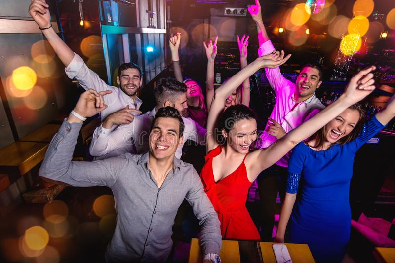 Group of friends partying in a nightclub stock images