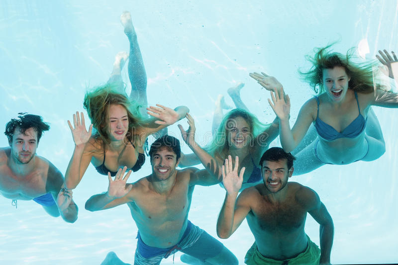 Group of young friends underwater royalty free stock photography