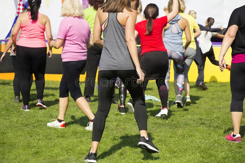 Group of young girls exercising fitness with dancing stock photos